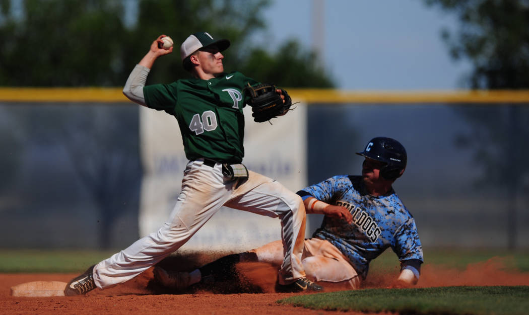 Palo Verde second baseman Nate Bartlett turns a double play as Centennial base runner Austin Kryszczuk slides into second base in the sixth inning of the 2018 NIAA Class 4A Sunset Region Champions ...