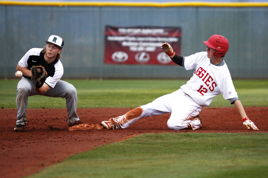 Arbor View Aggies' Jesse Pierce (12) slides into second base during a game against the Rancho Rams at Desert Oasis High School in Las Vegas on Saturday, March 10, 2018. The Rams won 10-4. Andrea C ...