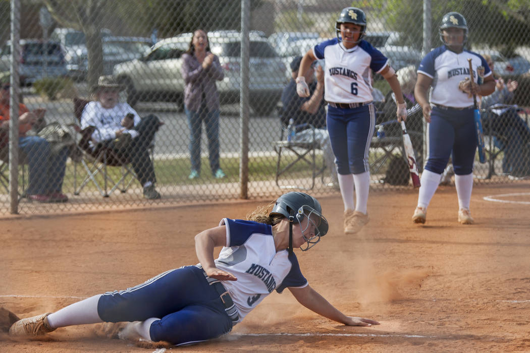 Shadow Ridge third baseman Caitlyn Covington slides into home base after a double and an error while playing against Palo Verde during the second inning at Shadow Ridge High School in Las Vegas on ...