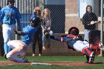 Centennial's Anthony Martinez, left, avoids a tag from Liberty's catcher James Katona as he scores the winning run during their baseball game at Centennial High School on Thursday, March 7, 2019, ...
