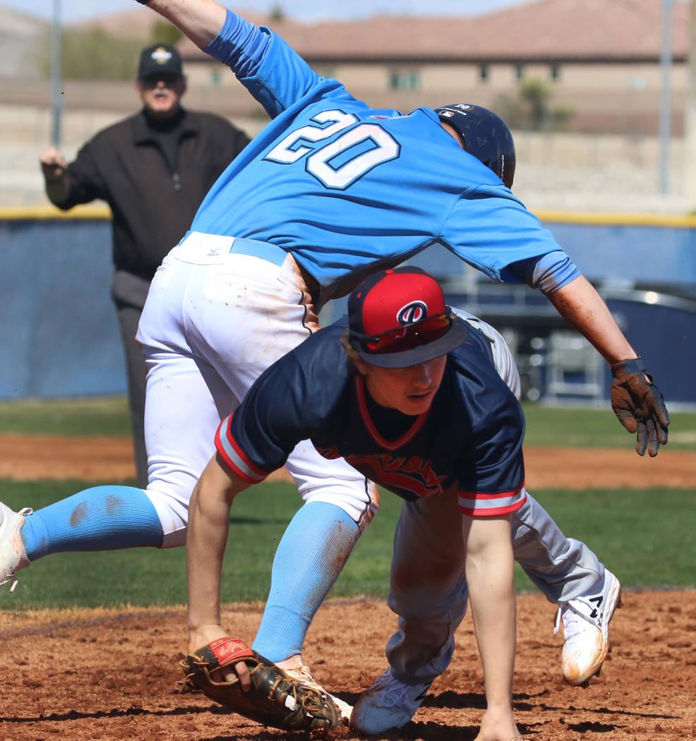 Centennial's Travis Rice (20) and Liberty's Ethan Safier collide at second during their baseball game at Centennial High School on Thursday, March 7, 2019, in Las Vegas. Centennial won 5-4. (Bizua ...