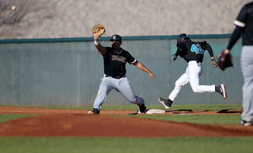 Silverado baserunner Caleb Hubbard (42) crosses first base as Faith Lutheran first baseman Jacob Ortega (8) waits for the throw during a baseball game at Silverado High School in Las Vegas Friday, ...