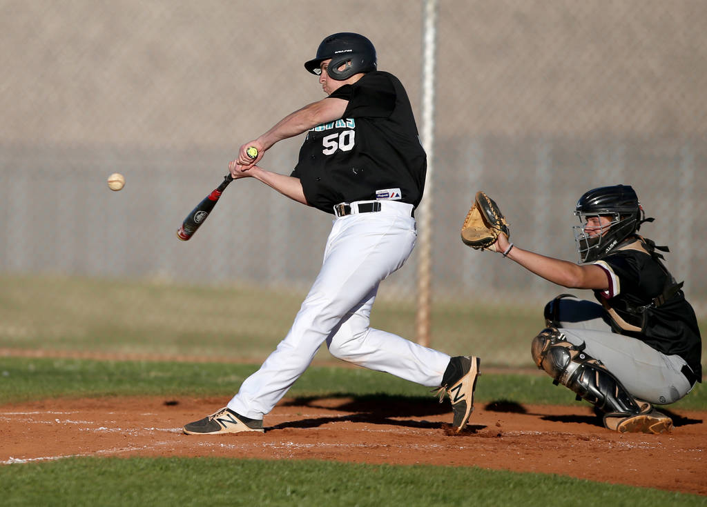 Silverado's Russell Macias (50) swings at a pitch as Carson Bonus catches during a baseball game at Silverado High School in Las Vegas Friday, March 8, 2019. (K.M. Cannon/Las Vegas Review-Journal) ...