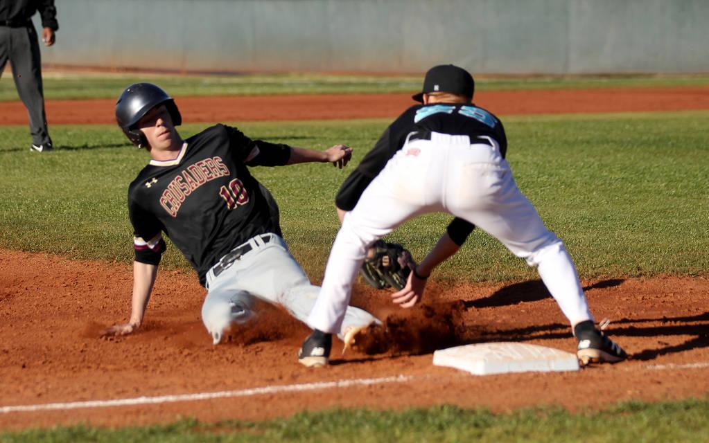 Silverado third baseman Austin Whittaker (25) tags out Faith Lutheran baserunner Michael Carroll (10) during a baseball game at Silverado High School in Las Vegas Friday, March 8, 2019. (K.M. Cann ...
