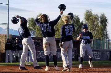 Centennial players Sam Simon (16), Kris Bow (42) and Rene Almarez (22) greet teammate Austin Kryszczuk after his two-run home run in the second inning against Arbor View on Saturday, March 9, 2019 ...