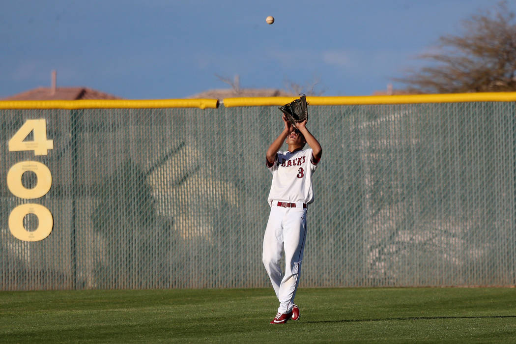 Desert Oasis' Tripp Edens (3) makes a catch in the outfield for an out against Palo Verde in the baseball game at Desert Oasis High School in Las Vegas, Tuesday, March 12, 2019. Erik Verduzco Las ...