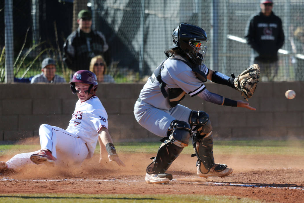 Desert Oasis' Colton Zobrist (7) slides home for a run against Palo Verde's Yuta Nakamura (52) in the baseball game at Desert Oasis High School in Las Vegas, Tuesday, March 12, 2019. Erik Verduzco ...