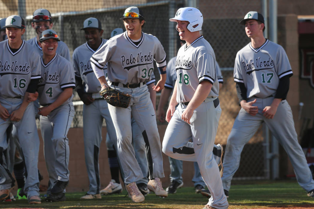 Palo Verde's Hunter Chynoweth (18), center, runs home for a run after hitting a homer against Desert Oasis in the baseball game at Desert Oasis High School in Las Vegas, Tuesday, March 12, 2019. E ...