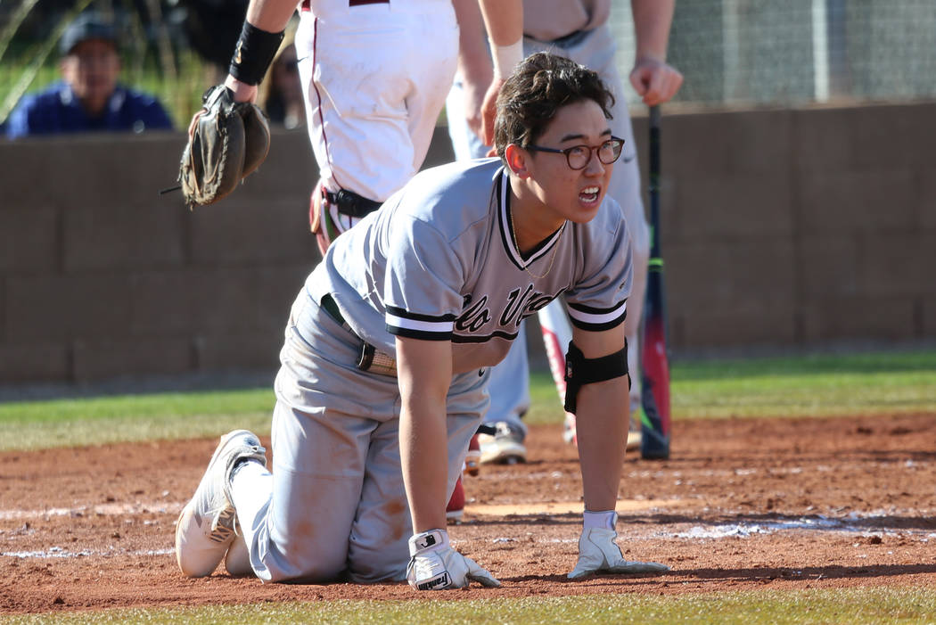 Palo Verde's Tyler Kim (6) injures his leg while batting against Desert Oasis in the baseball game at Desert Oasis High School in Las Vegas, Tuesday, March 12, 2019. Erik Verduzco Las Vegas Review ...