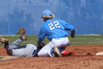 Centennial's shortstop Rene Almarez (22) tags Liberty's Chase Galleps at second during their baseball game at Centennial High School on Thursday, March 7, 2019, in Las Vegas. Centennial won 5-4. ( ...
