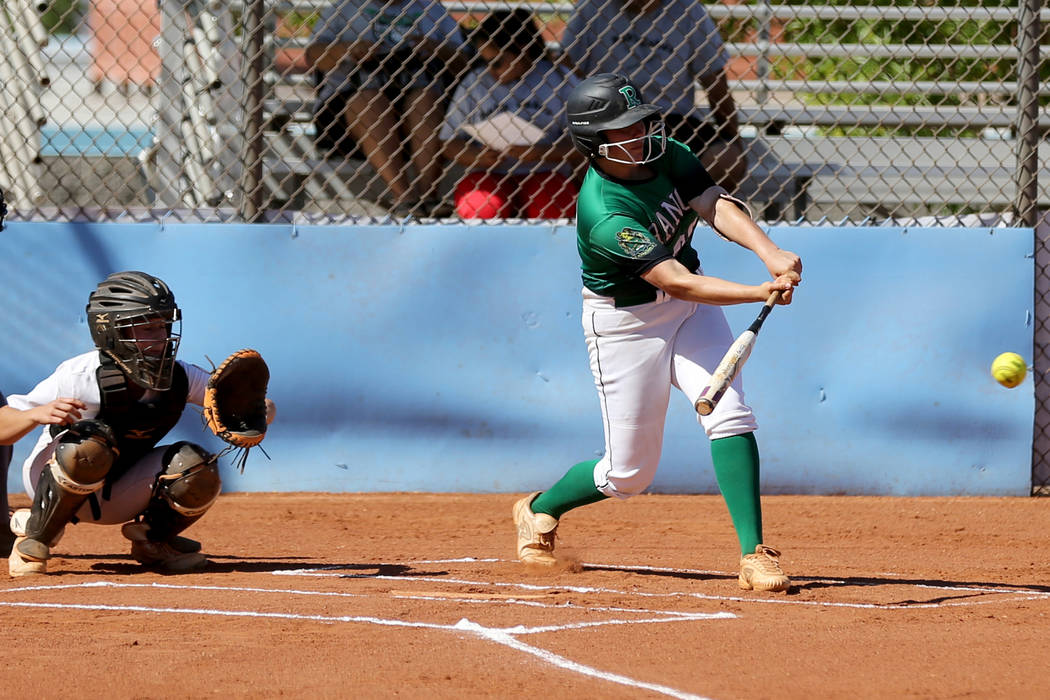 Rancho's MacKenzie Perry (99) gets a hit against Foothill in the first inning of their softball game at Foothill High School in Henderson Thursday, April 26, 2018. K.M. Cannon Las Vegas Review-Jou ...