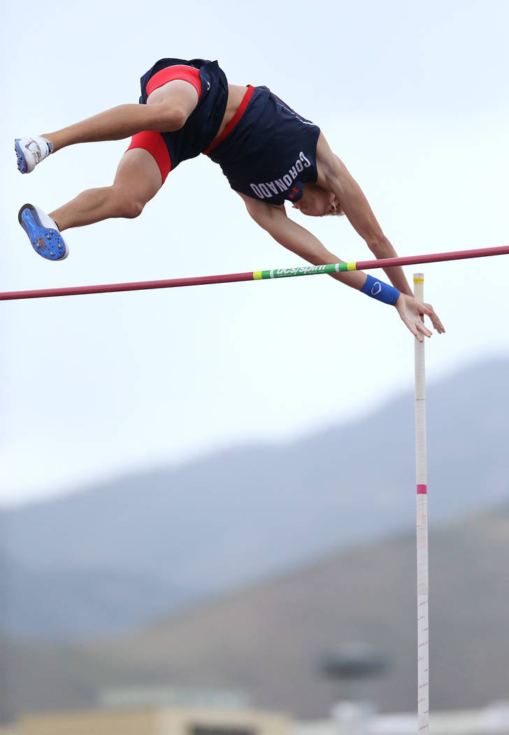 Coronadoճ Keaton Daniel clears 15ՠin the pole vault to tie for the title at the NIAA Track & Field Championships at Carson High in Carson City, Nev., on Friday, May 18, 2018. Cathl ...