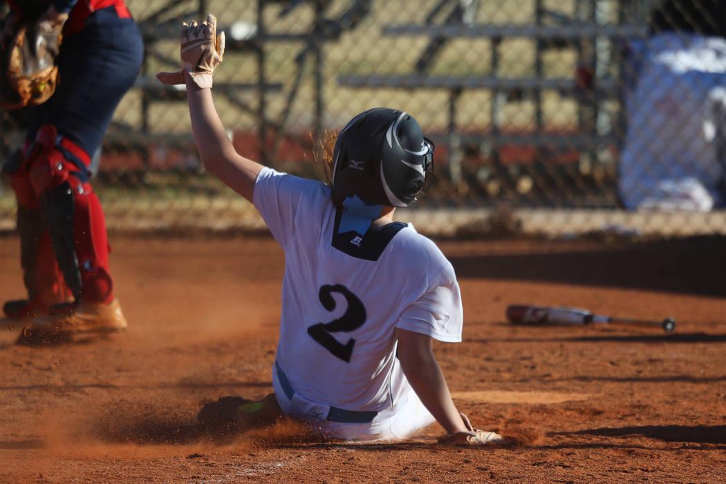 Centennial's Ryan Rogers (2) slides home for a run against Coronado in the softball game at Centennial High School in Las Vegas, Wednesday, March 13, 2019. Erik Verduzco Las Vegas Review-Journal @ ...