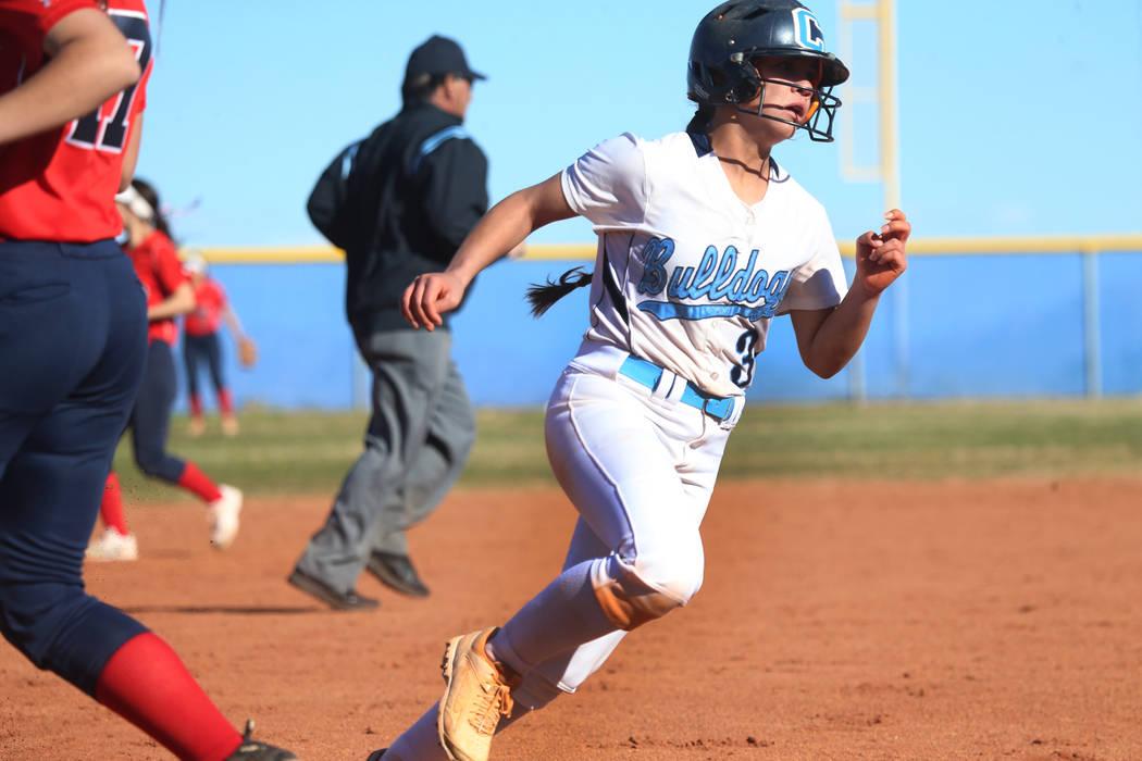 Centennial's Natasha Lawrence (3) runs home for a run against Coronado in the softball game at Centennial High School in Las Vegas, Wednesday, March 13, 2019. Erik Verduzco Las Vegas Review-Journa ...