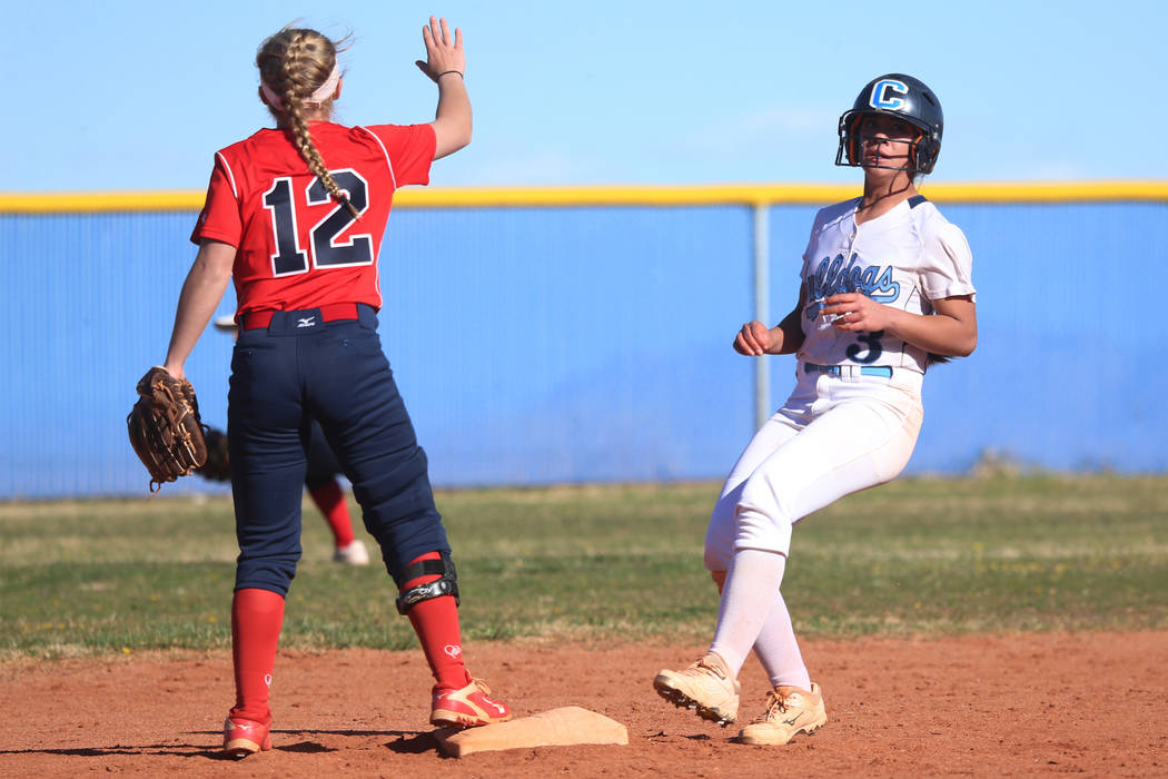 Centennial's Natasha Lawrence (3) runs to second base for a double against Coronado's Paige Sinicki (12) in the softball game at Centennial High School in Las Vegas, Wednesday, March 13, 2019. Eri ...