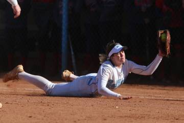 Centennial's Tatum Huntly (9) makes a diving catch for an out against Coronado in the softball game at Centennial High School in Las Vegas, Wednesday, March 13, 2019. Erik Verduzco Las Vegas Revie ...