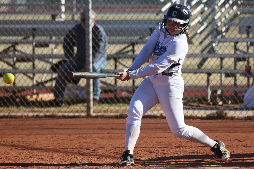 Centennial's Ashlynn Heck (8) hits the ball against Coronado in the softball game at Centennial High School in Las Vegas, Wednesday, March 13, 2019. Erik Verduzco Las Vegas Review-Journal @Erik_Ve ...