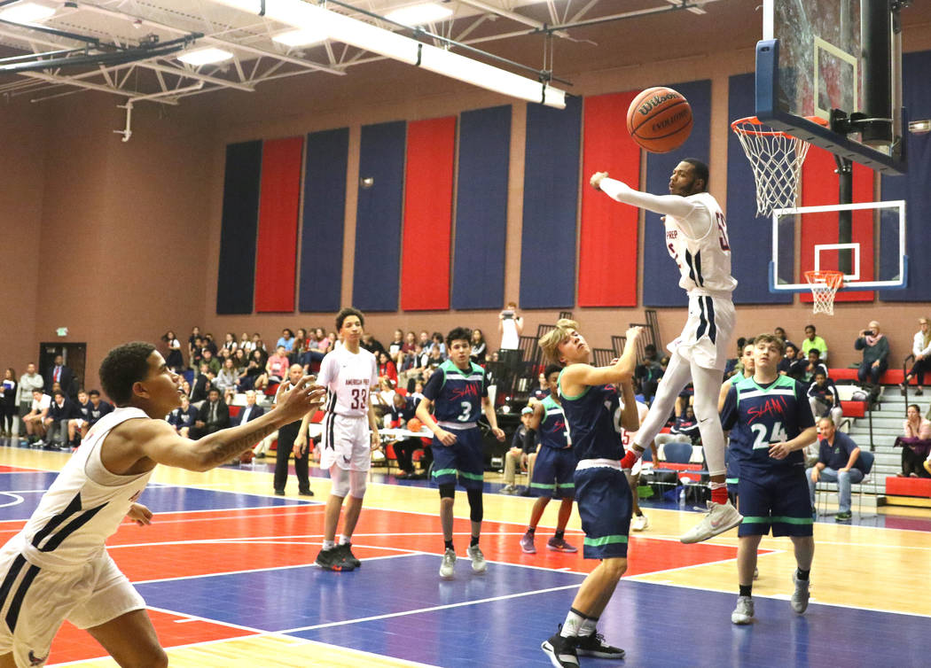 Darren Jones (52) swats away a shot made by a SLAM Academy player during a varsity basketball game at American Preparatory Academy in Las Vegas, Thursday, Jan. 17, 2019. (Heidi Fang /Las Vegas Rev ...