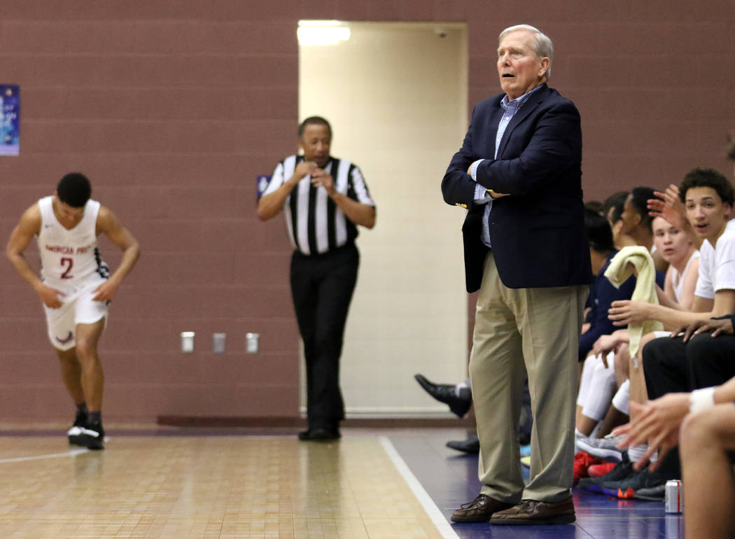 American Preparatory Academy basketball coach and athletic director Dave Bliss, right, shouts instructions to his team during a home game against SLAM Academy in Las Vegas, Thursday, Jan. 17, 2019 ...