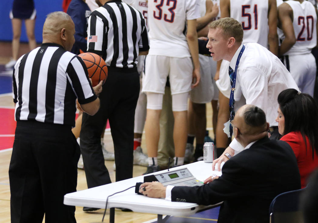 American Preparatory Academy's secondary director, Nik Hulet, right, speaks to a referee during a varsity basketball game played against SLAM Academy on his school's campus in Las Vegas, Thursday, ...