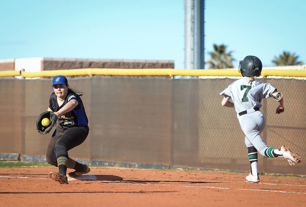 Sierra Vista's Mia Buranamontri (54) catches the ball as Palo Verde's Kendall Menke (7) runs to first base in the first inning of a softball game against at Sierra Vista High School in Las Vegas ...