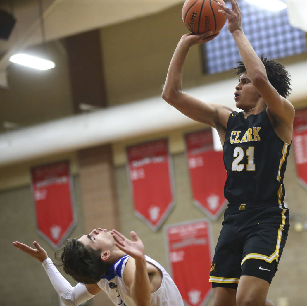 Clark's Jalen Hill (21) shoots over Desert Pines' Milos Uzan (12) during the second half of a Class 4A state boys basketball quarterfinal game at Arbor View High School in Las Vegas on Wednesday, ...