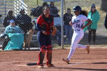 Centennial's Maddie Kallfelz (14) runs home for a run after a hit by Tatum Huntly (9) as Coronado's catcher Isabel Rodriguez (3) looks on in the softball game at Centennial High School in Las Vega ...