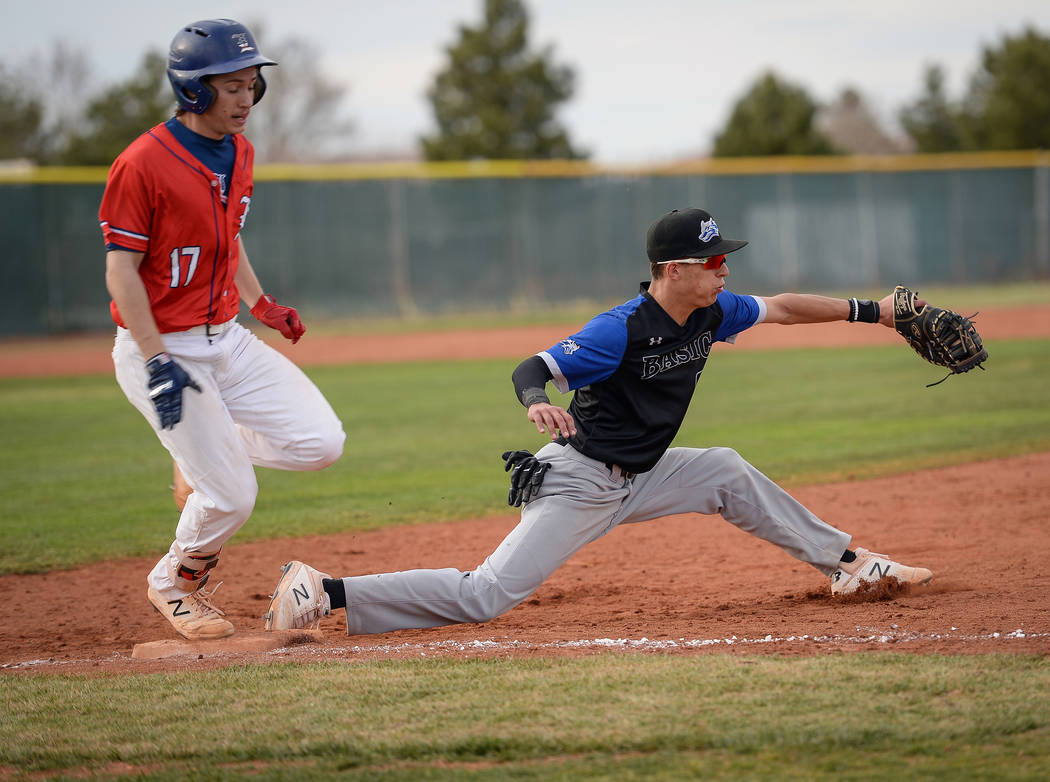 Basic's John Howard Bobo (99) catches the ball getting out Liberty's Ethan Safier (17) in the seventh inning of a baseball game at Liberty High School in Henderson, Tuesday, March 19, 2019. (Carol ...