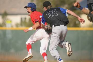 Liberty's Dylan San Nicolas (3) runs away as Basic's Shane Spencer (22) tries to get him out in the fourth inning of a baseball game at Liberty High School in Henderson, Tuesday, March 19, 2019. ( ...