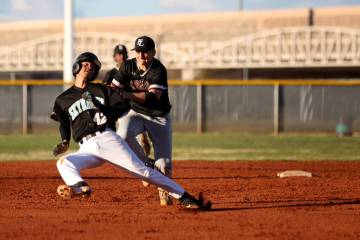Faith Lutheran shortstop Parker Sylvester (5) tags out Silverado baserunner Caleb Hubbard (42) in a rundown during a baseball game at Silverado High School in Las Vegas Friday, March 8, 2019. (K.M ...