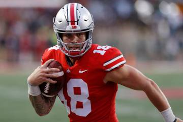 In this Sept. 22, 2018, file photo, Ohio State quarterback Tate Martell runs against Tulane during an NCAA college football game in Columbus, Ohio. (AP Photo/Jay LaPrete, File)