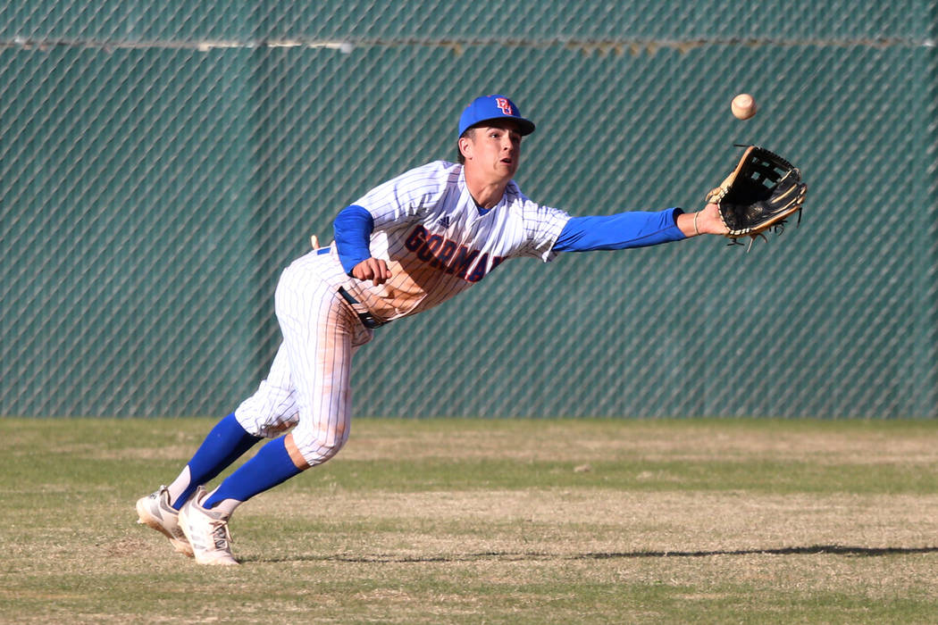 Bishop Gorman's Carson Wells (9) dives for a catch in the outfield against Desert Oasis in the baseball game at Bishop Gorman High School in Las Vegas, Thursday, March 21, 2019. Desert Oasis won 4 ...