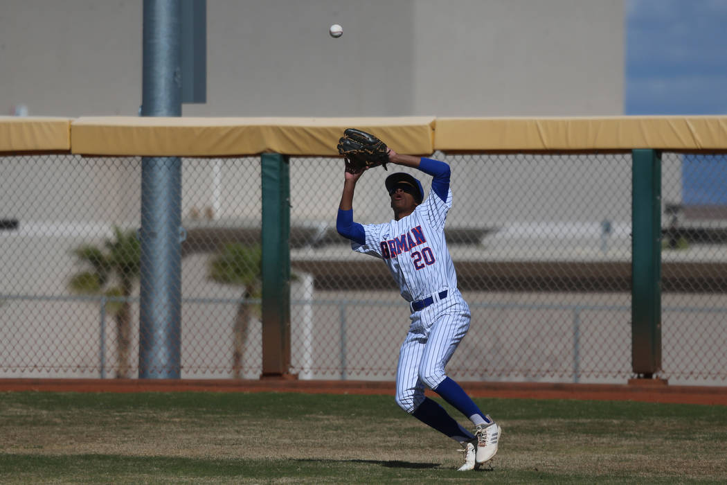 Bishop Gorman's Noah Gulley (20) makes a catch in the outfield against Desert Oasis in the baseball game at Bishop Gorman High School in Las Vegas, Thursday, March 21, 2019. Desert Oasis won 4-0. ...