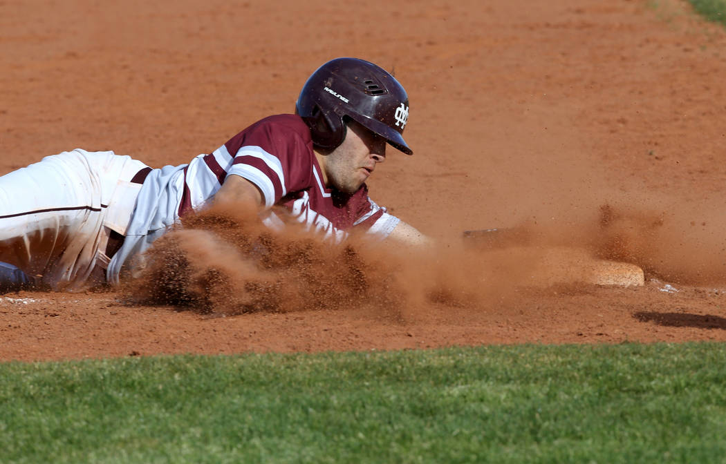 Cimarron-Memorial baserunner Lawrence Campa (15) slides safely into third base in the third inning of their baseball game at Cimarron-Memorial High School in Las Vegas Friday, March 22, 2019. (K.M ...