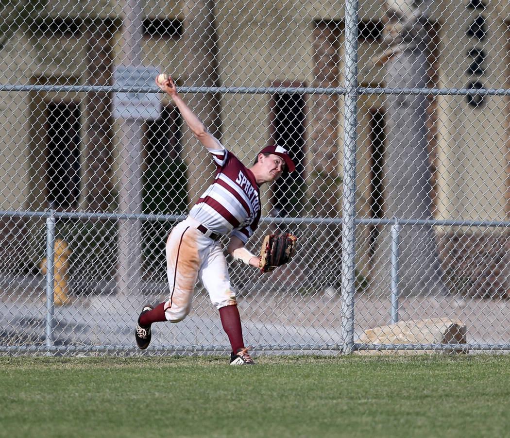 Cimarron-Memorial ourfielder Anthony Ortiz (12) throws in against Silverado in the fourth inning of their baseball game at Cimarron-Memorial High School in Las Vegas Friday, March 22, 2019. (K.M. ...