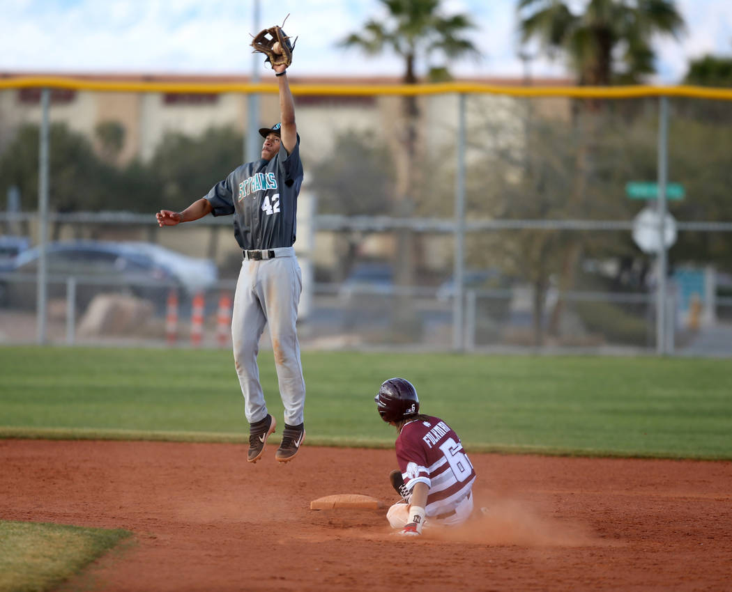 Cimarron-Memorial Jackson Folkman (6) slides safely into second base as Silverado second baseman Caleb Hubbard (42) fields the throw in the fourth inning of their baseball game at Cimarron-Memoria ...