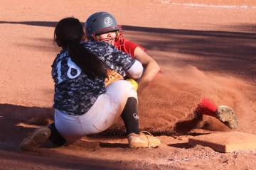 Liberty's Jessica Meza (20) slides safe for a triple against Desert Oasis' Jaid Riana Raval (18 ...