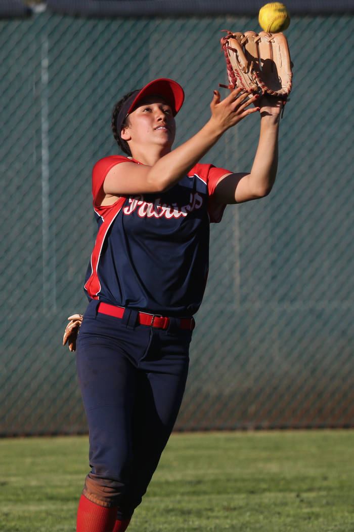 Liberty's Shelby Carvalho (13) makes a catch in the outfield against Desert Oasis in the softba ...