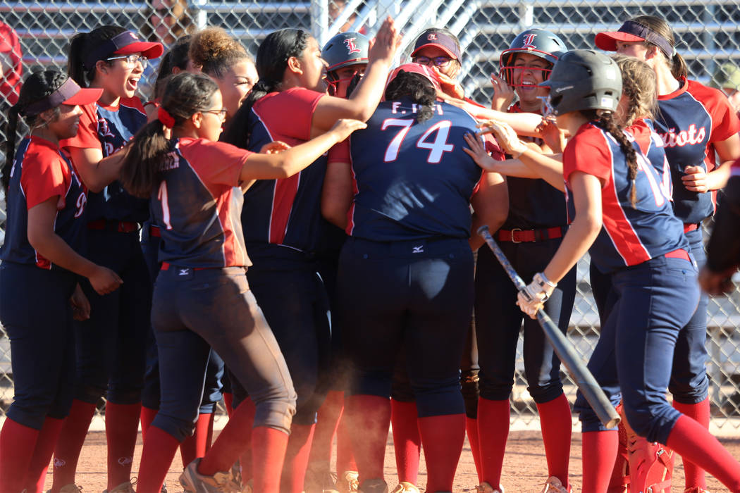 Liberty's Fia Tofi (74) celebrates a two-run homer with her team in the softball game against D ...