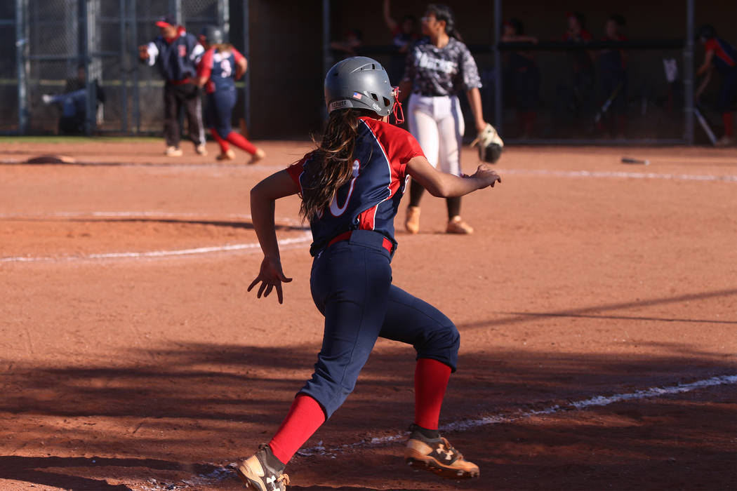 Liberty's Jessica Meza (20) runs home for a run against Desert Oasis in the softball game at De ...