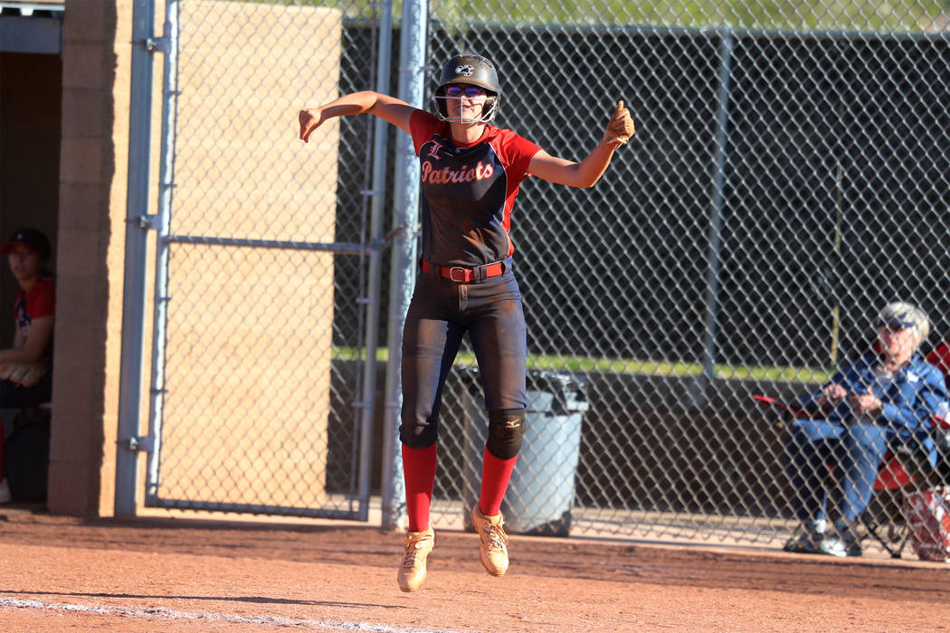 Liberty's McKenzie LaNeve (42) celebrates a run by her team in the sixth inning against Desert ...