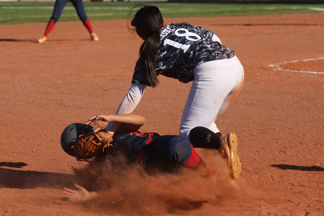 Desert Oasis' Jaid Riana Raval (18) tags out Liberty's Rebecca Warren (1) at third base in the ...