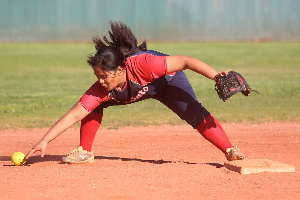 Liberty's Debra Tofi (44) fails to make a play to allow a base hit against Desert Oasis in the ...