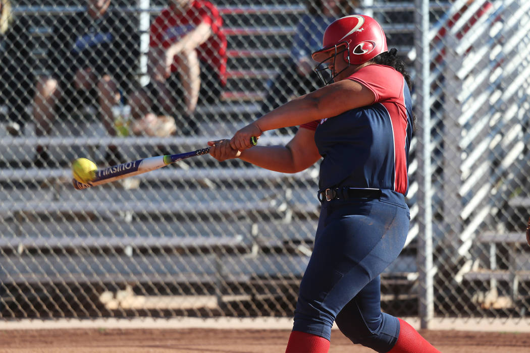 Liberty's Fia Tofi (74) connects for a double against Desert Oasis at Desert Oasis High School ...