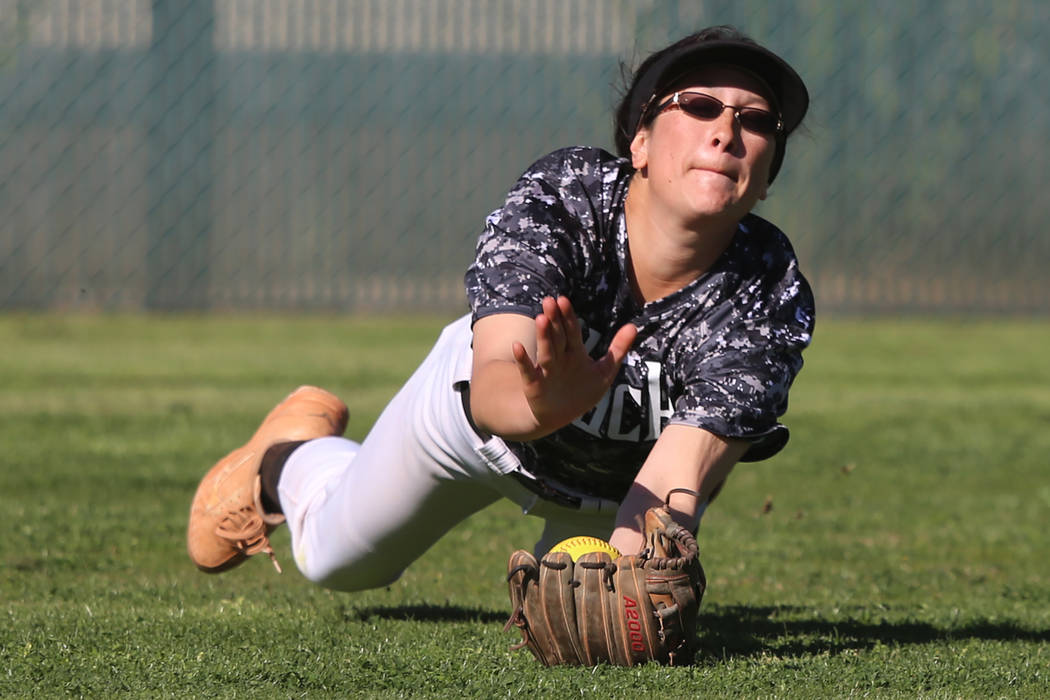 Desert Oasis' Makayla Rickard (23) makes a diving catch for an out against Liberty in the softb ...