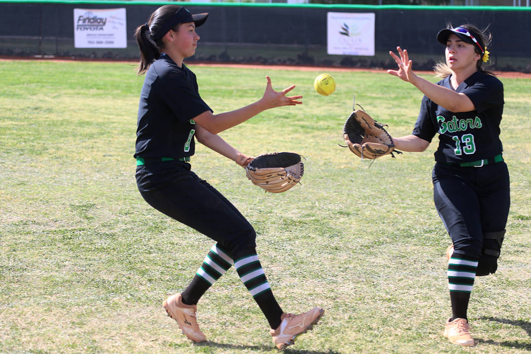 Green Valley's Alyssa Vigil (8), left, and Cinthia Garcia (13), watch as the ball drops in the ...
