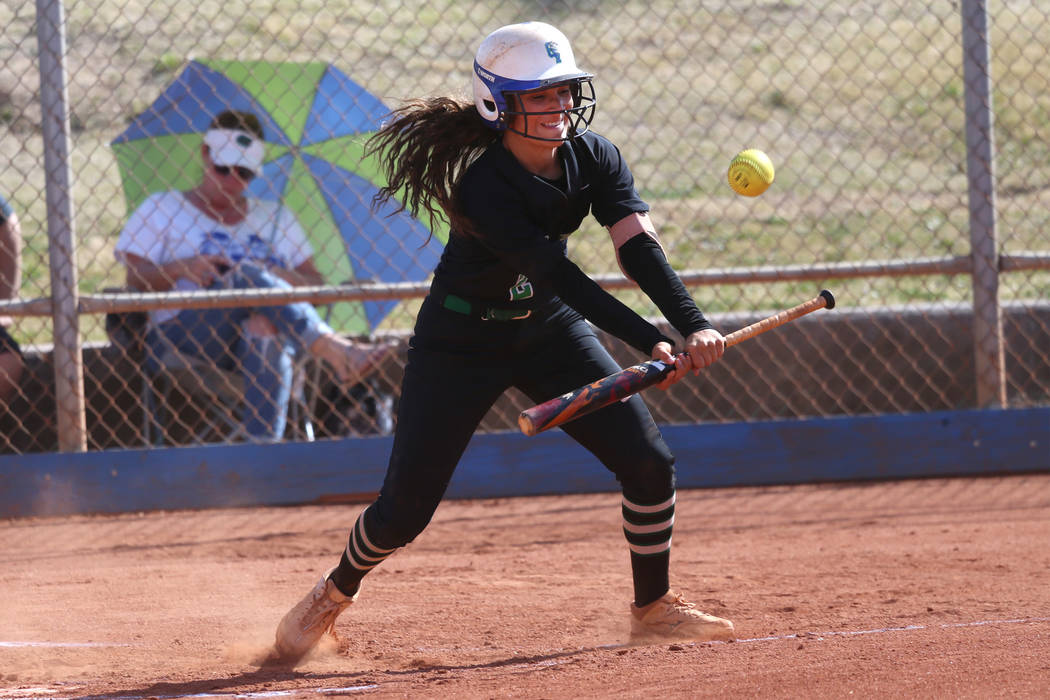 Green Valley's Olivia McClain (2) bunts the ball for a fly ball and an out against Foothill in ...