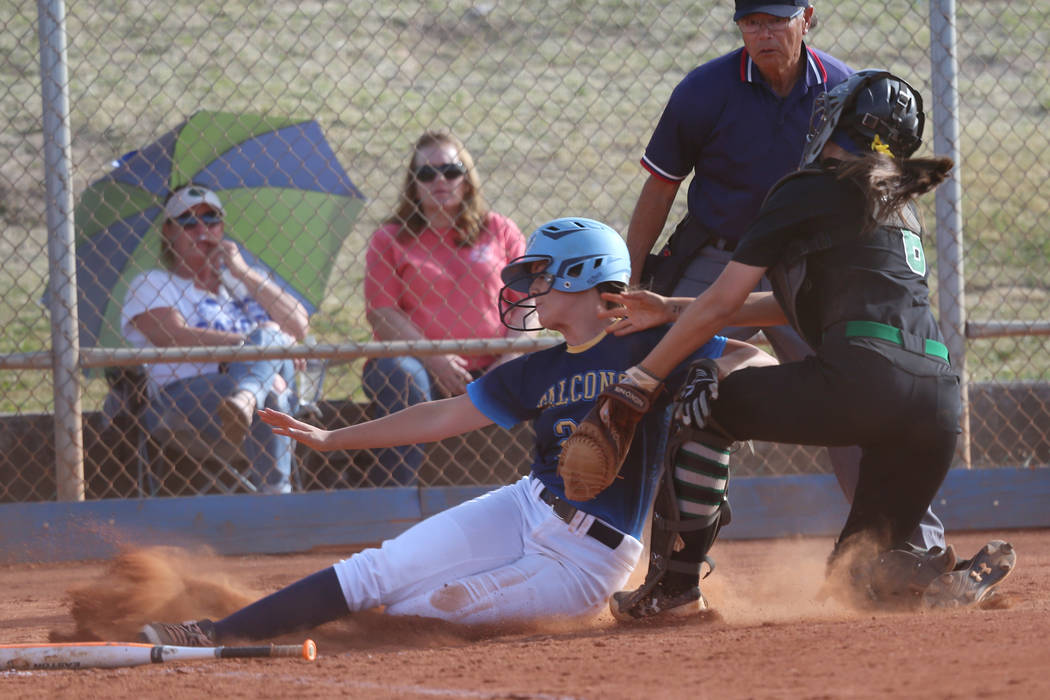 Foothill's Adrienne Higgins (21) slides home for an out against Green Valley's Angelina Ortega ...