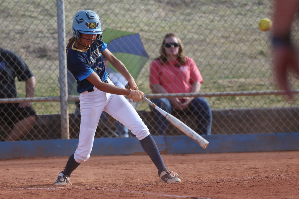 Foothill's Layla Que (15) connects will the ball for a single against Green Valley in the softb ...