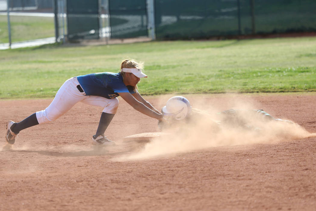 Foothill's Angelina Rodriguez (6) tags out Green Valley's Cindy Martinez-Escamilla (7) at secon ...